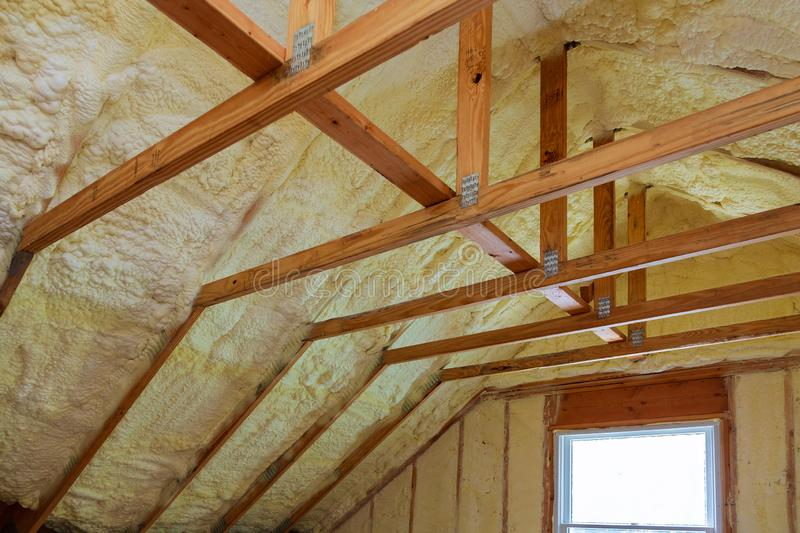 Insulation of attic with foam polyurea insulation cold barrier and insulation material. Insulation of attic with foam insulation cold barrier and insulation royalty free stock photo