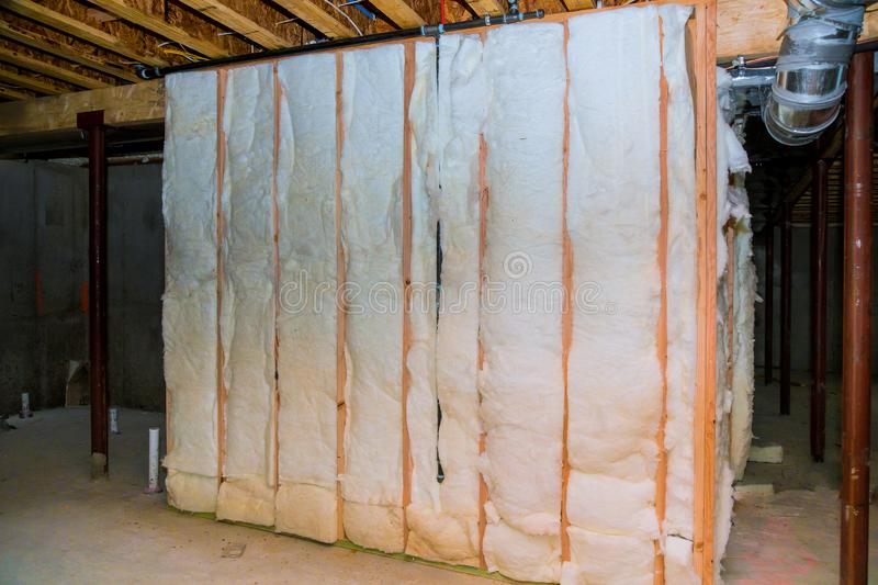 Insulation of basement with fiberglass cold barrier and insulation material. Insulation of basement with fiberglass of house with insulation material, thermal stock photos
