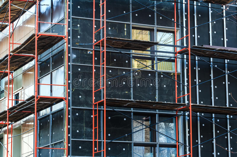 Insulation of building wall under construction stock photo for Time saver details for exterior wall design