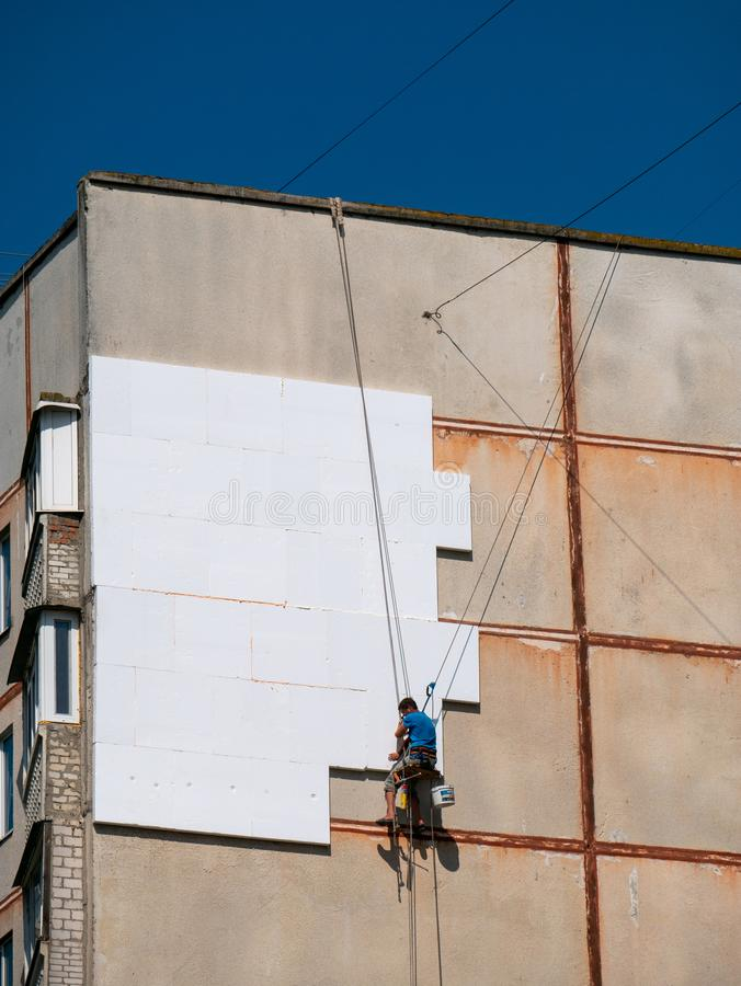 Insulation and Energy Saving Technology Concept. Worker Making B. Uilding with heat insulated facade stock photos