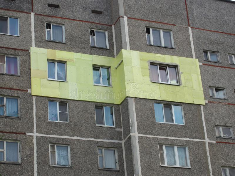 Insulation of the exterior walls of apartments in a high-rise building royalty free stock image