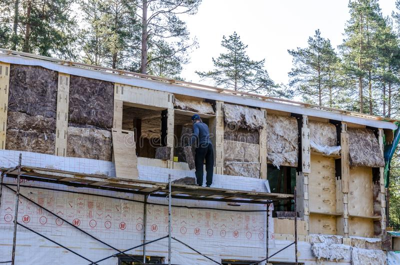 The insulation of a frame house of mineral wool, walls made of plywood royalty free stock image