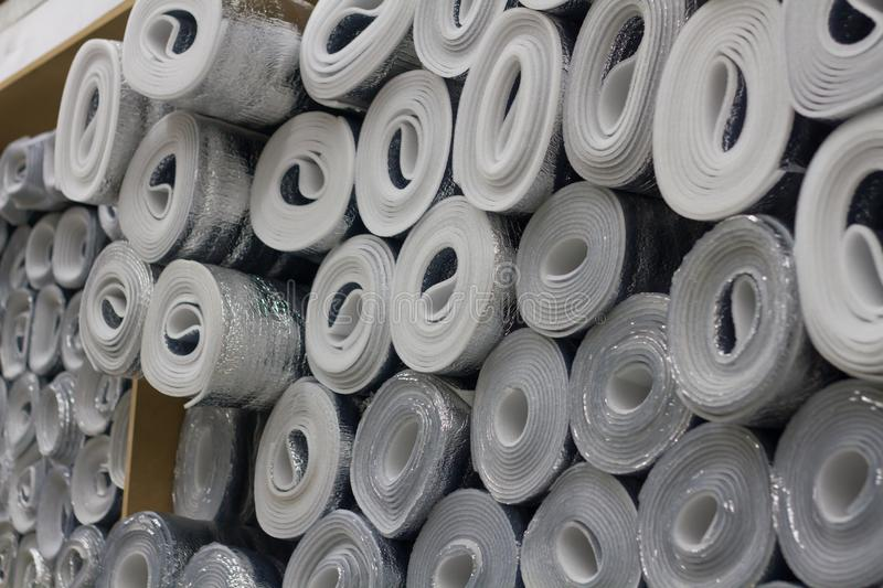 Insulation material in rolls for wholesale. Warehouse store stock image