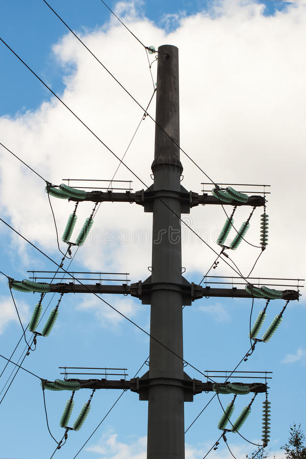 Insulators of Power line are support conductors and withstand surges due to switching lightning. Insulators of Power line are support the conductors and stock photos