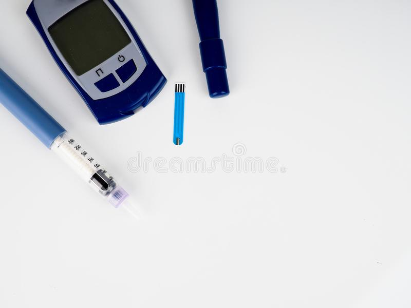 Insulin injection needle or pen for use by diabetics, insulin and glucometer.  stock photography