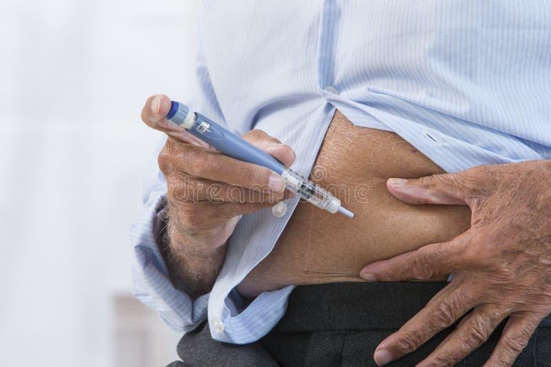 Insulininjektion fotografering för bildbyråer