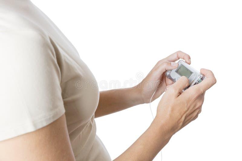 Insulinpumpen fotografering för bildbyråer