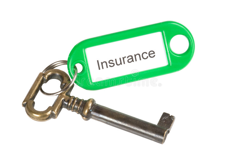 Insurance. A key with an insurance label isolated on white royalty free stock images