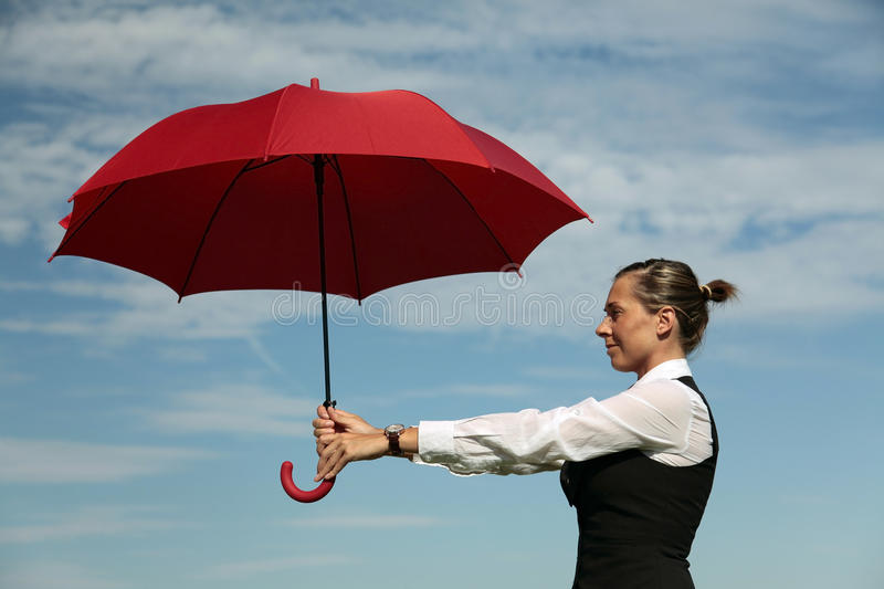 Insurance Agent. Protects you. Businesswoman with Red Umbrella stock photo
