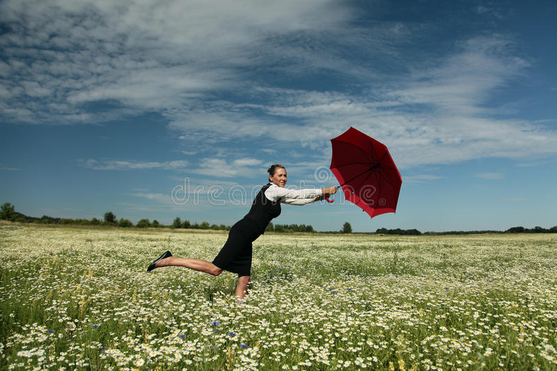 Insurance Agent. Protects you. Businesswoman with Red Umbrella royalty free stock photos