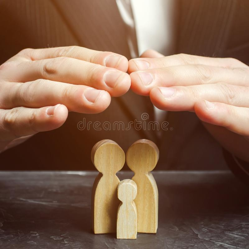 Insurance agent. The concept of insurance of family life and property. Health insurance, care. Security and Property Protection.  stock image