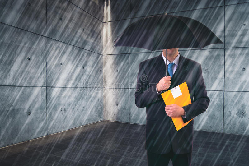 Insurance Agent with Umbrella in Urban Setting. Insurance Agent with Umbrella Protecting from Rain in Urban Outdoor Setting, Risk Assessment and Anlysis royalty free stock images