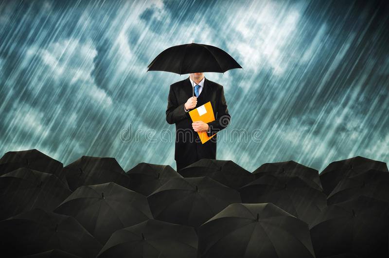 Insurance agents. In heavy rain. Businessmen with umbrella gathering for protest royalty free stock images
