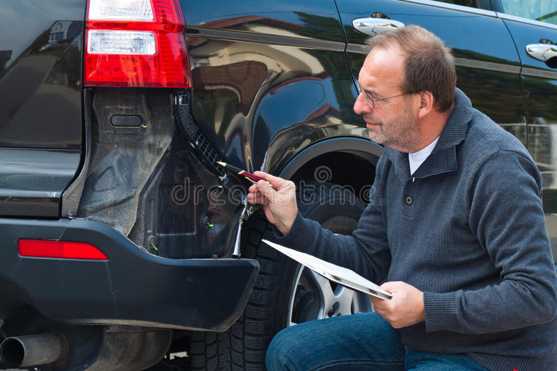 Insurance claim on. An insurance expert. Case of damage to the car. Car Insurance stock images