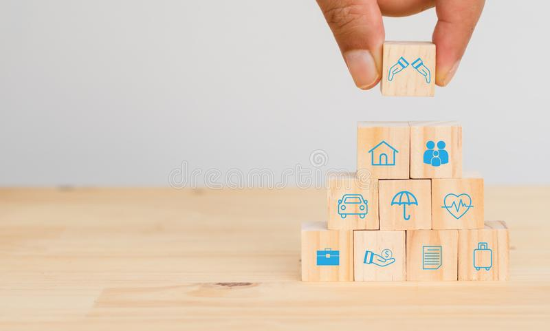 Insurance concept, hand man try to put the insurance to protect or cover person, Property ,Liability, reliability,car, life, busin royalty free stock images