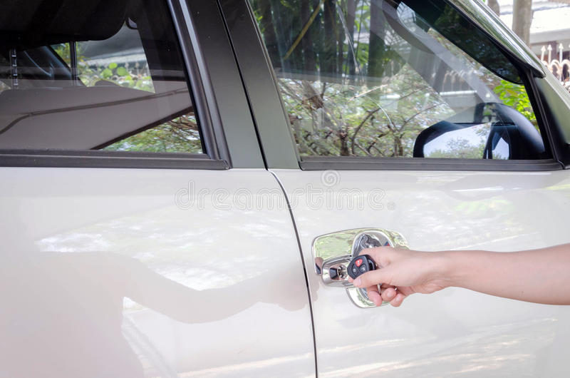 Insurance concept, hand woman with black car key. Insurance concept, hand woman holding black car key stock photo