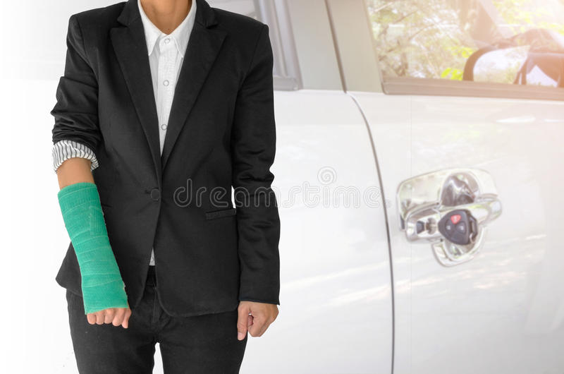 insurance concept, injured businesswoman with green cast on hand royalty free stock photography