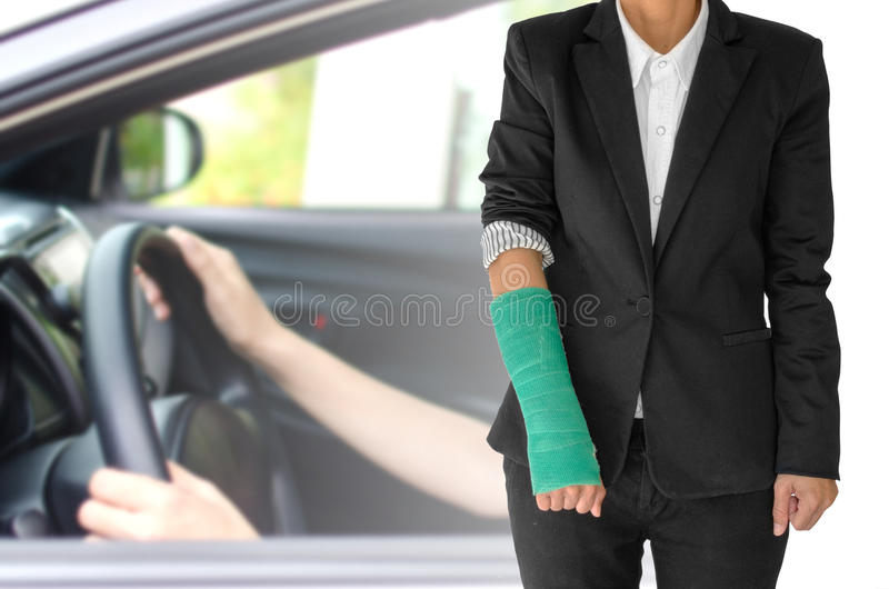 insurance concept, injured businesswoman with green cast on hand royalty free stock photo