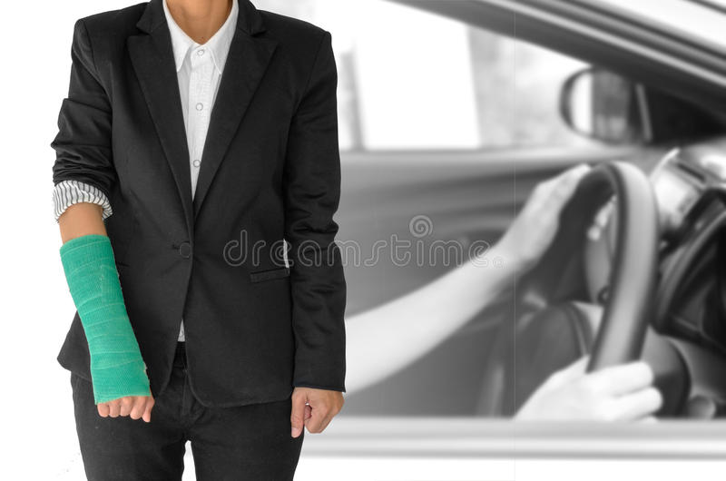 insurance concept, injured businesswoman with green cast on hand royalty free stock image