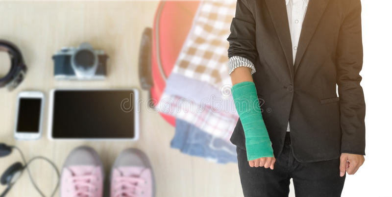 insurance concept, injured businesswoman with green cast on hand stock photo