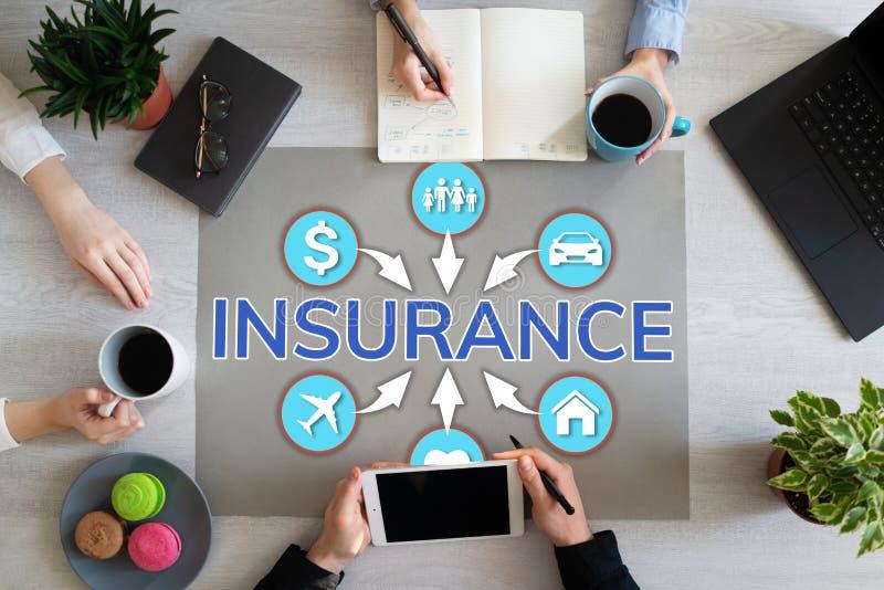 Insurance concept on office desktop life health care money travel. stock photos