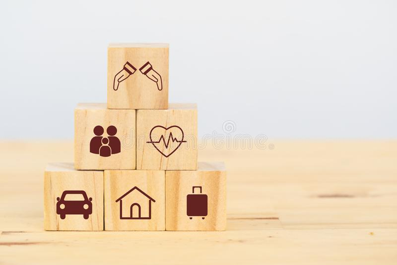 Insurance concept, wooden cube symbolize put the insurance to protect or cover person, Property ,Liability, reliability,car, life, stock image
