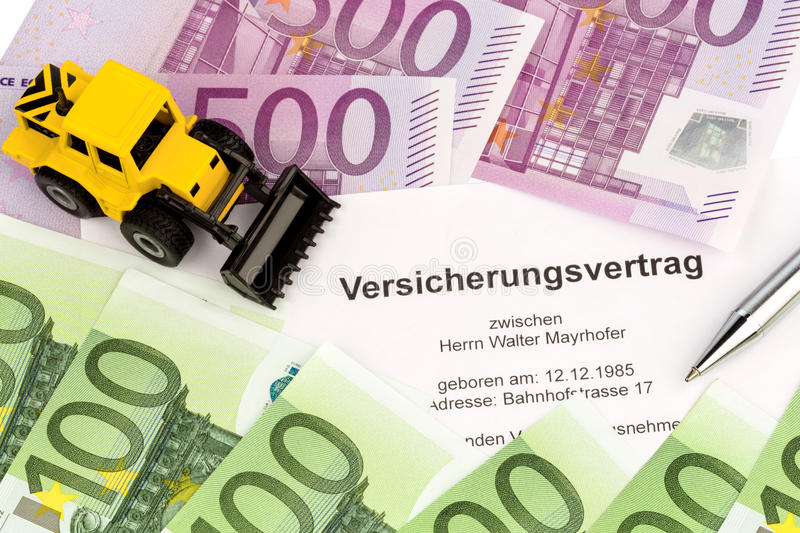 Insurance contract for new excavator. Located on euro banknotes stock image