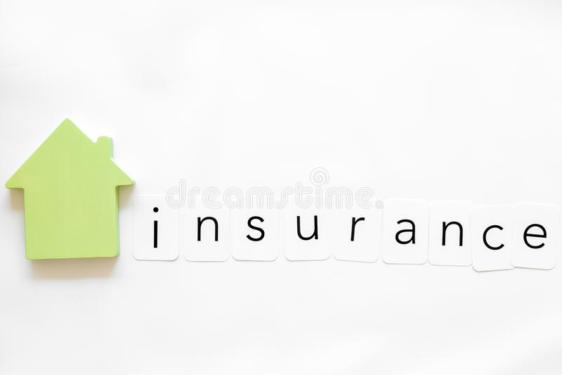 Insurance copy with house figure on white background top view mock up. Buy and insure house concept. Insurance copy with house figure on white background top royalty free stock photo