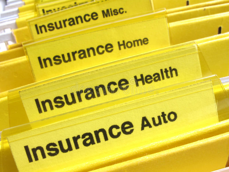 Insurance folders. Yellow folders show different types of insurance papers stock photography