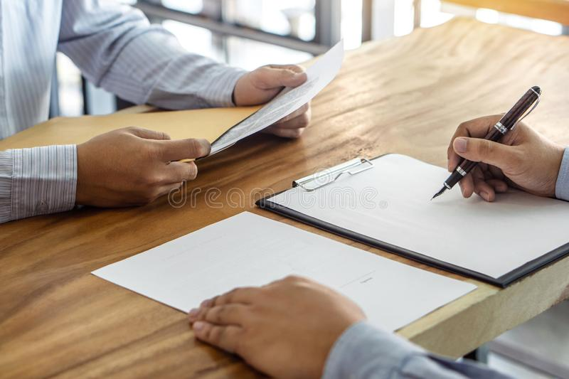 Insurance or loan real estate, Agent broker and client signing contract agreement approved to buy property had passed the. Examination royalty free stock image