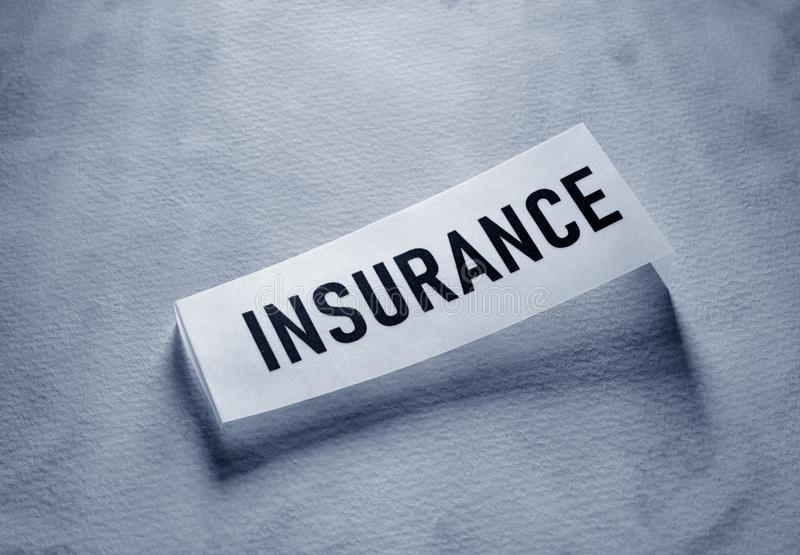 Insurance Tag label. Close up of insurance tag label on paper stock image