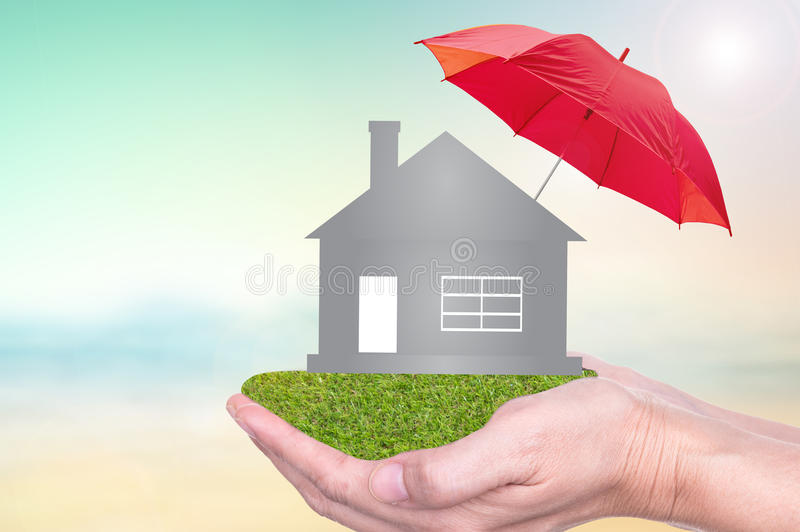 Insurance to protection by umbrella. Home insurance concept of home on hands of insurance agent to protection by umbrella royalty free stock photo