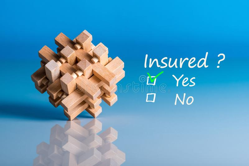 Insure concept. Survey with question Insured. Yes or no. Car, life insurance, home, travel and healt insurance.  stock photo