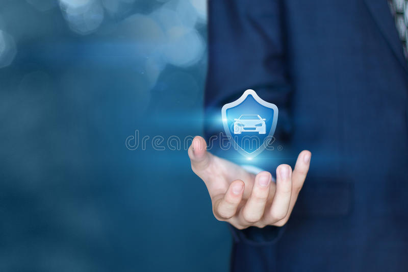 Insurer and icon of a car. royalty free stock photo
