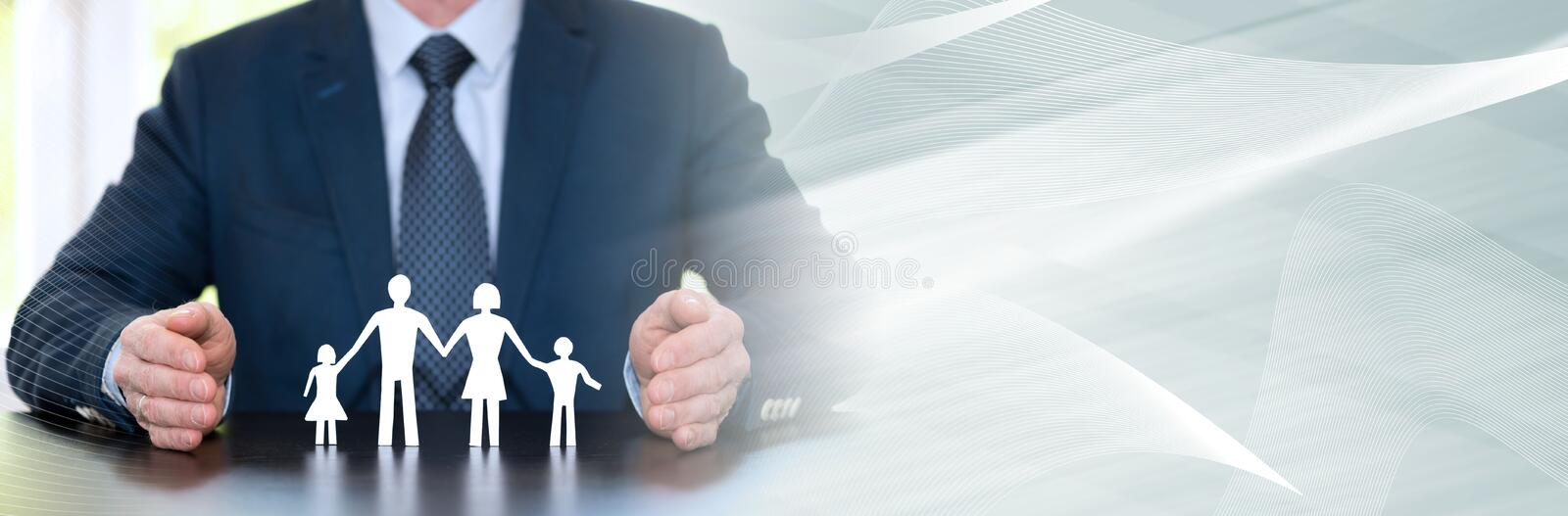 Concept of family insurance. panoramic banner. Insurer protecting a family with his hands. panoramic banner royalty free stock photos