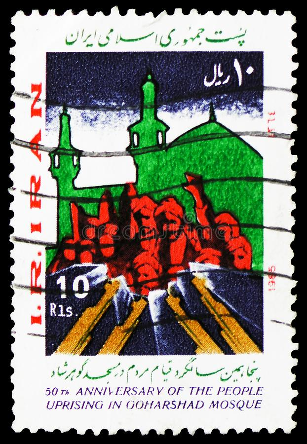 Insurgents in front of the mosque, 50th ann. of the uprising in the Goharschad Mosque serie, circa 1985. MOSCOW, RUSSIA - MARCH 23, 2019: A stamp printed in Iran royalty free stock photo