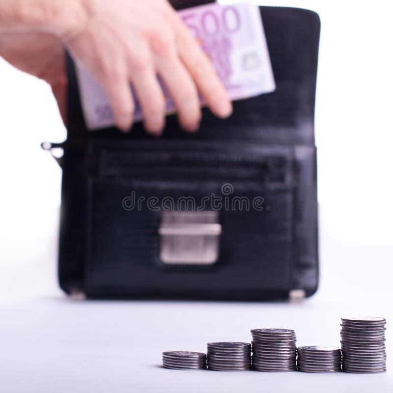 intäkt pengar arkivbild
