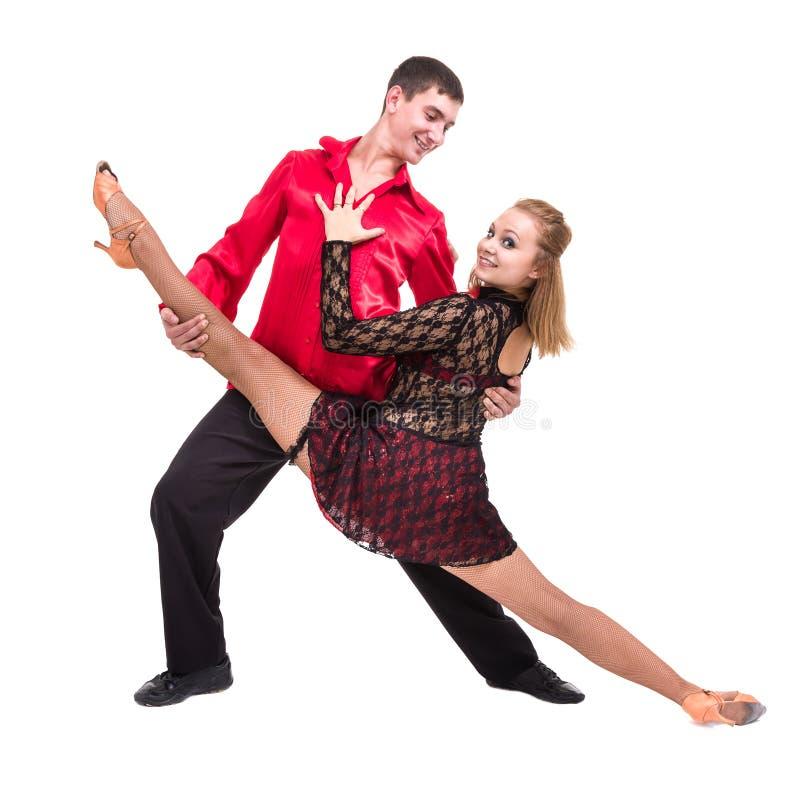 Intégral de la jeune danse de couples de ballet contre le blanc d'isolement photos stock