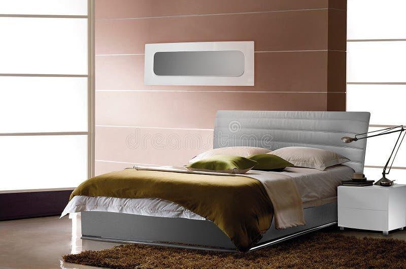 Intérieur pour une chambre à coucher, un lit photo stock