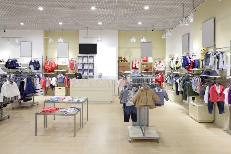 Intérieur tout neuf de magasin de tissu d'enfants photo libre de droits