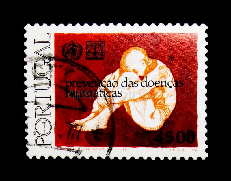 Int. Jaar Bestrijding rheuma, World Year of rheumatism and Reumatologica serie, circa 1977. MOSCOW, RUSSIA - NOVEMBER 24, 2017: A stamp printed in Portugal shows royalty free stock photography