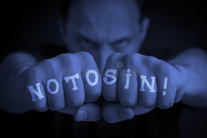 INTE ATT SYNDA skriftligt på ilskna man'snävar arkivfoton