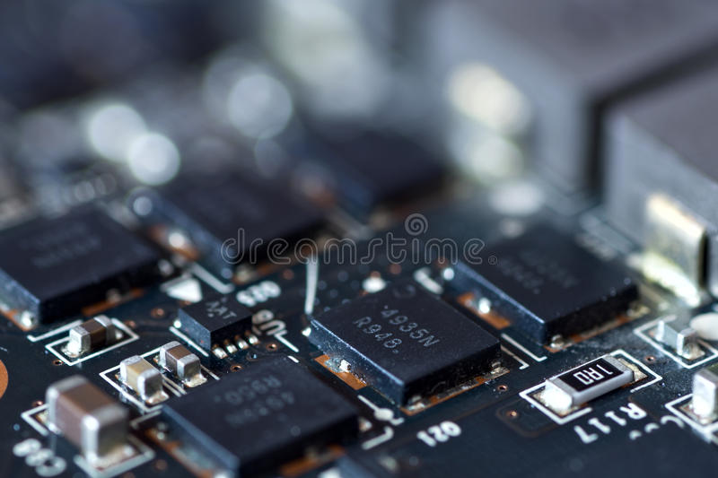 Integral circuit on board. Integral circuit mounted on circuit board close-up royalty free stock photos