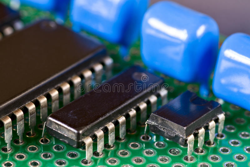 Integral circuits on Printed Circuit Board. Integral circuits and capacitors on Printed Circuit Board royalty free stock image