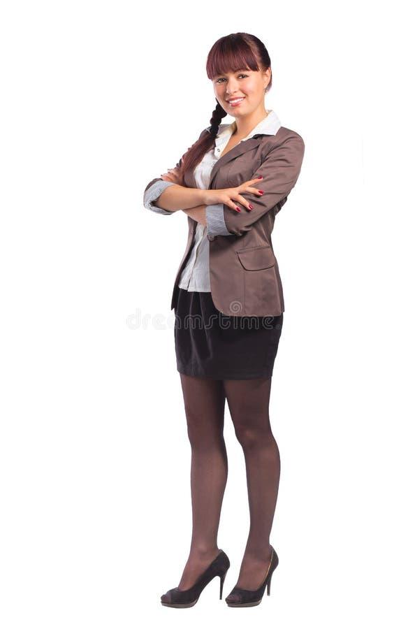 Integral de la mujer de negocios hermosa que se coloca con el folde de los brazos fotos de archivo
