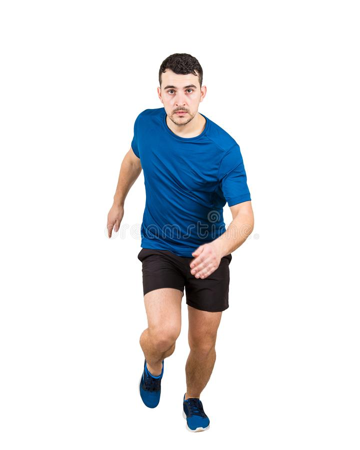 Integral de la velocidad rápida del atleta caucásico resuelto del hombre que corre a la cámara aislada sobre el fondo blanco imagenes de archivo