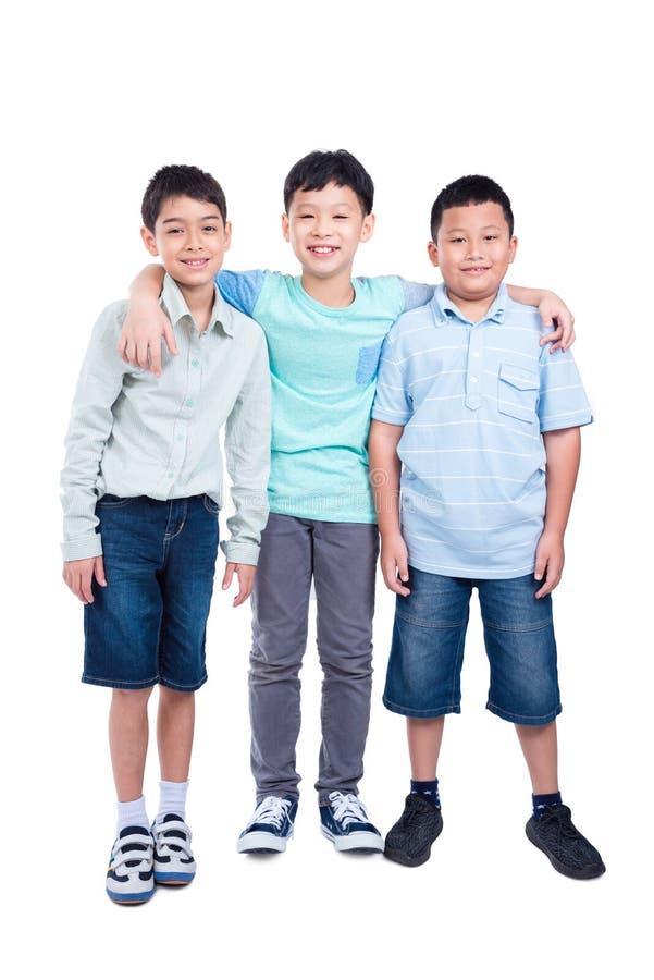 Integrale del ragazzo di scuola tre sopra bianco fotografie stock libere da diritti