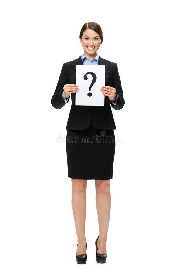 Integrale della donna di affari che passa il punto interrogativo fotografia stock libera da diritti