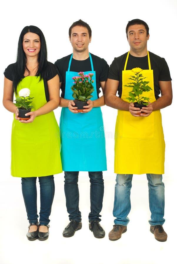 Integrale di una squadra dei tre fioristi fotografie stock libere da diritti