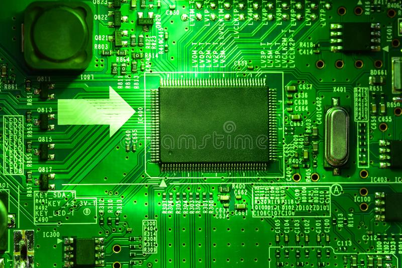 Integrated electronic circuit and microprocessor in a bright green light. Selective focus, integrated electronic circuit and microprocessor in a bright green royalty free stock image